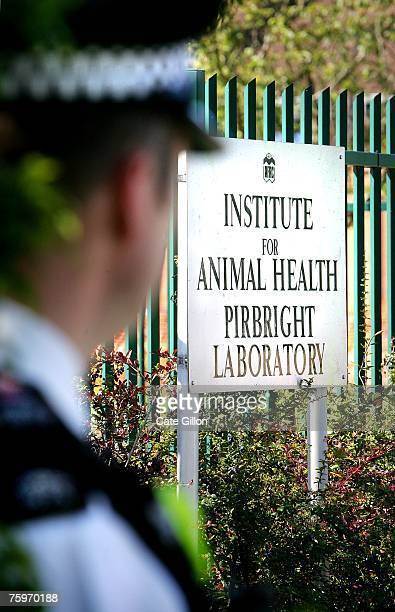 A police officer stands near the sign outside the Institute for Animal Health Pirbright Laboratory on August 5 2007 in Pirbright England The outbreak...