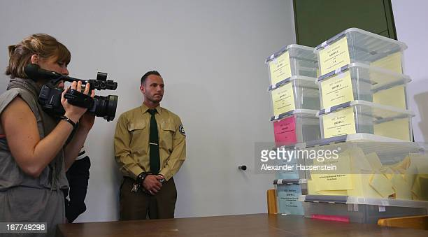 Police officer stands next to a lottery box during the media conference following the lottery draw for the 50 media spots inside the courtroom for...