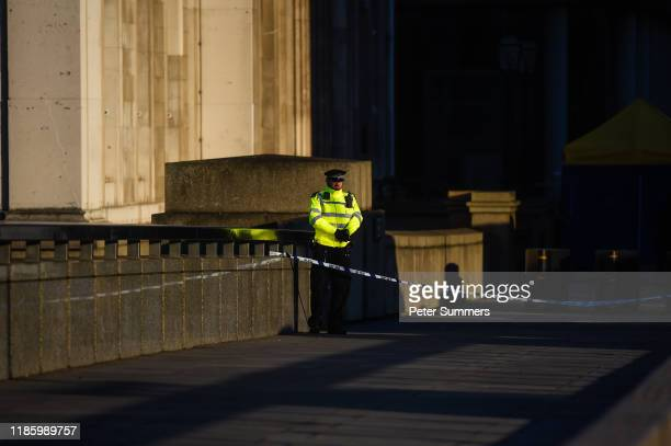 Police officer stands next to where Usman Khan was shot on London Bridge on December 2 2019 in London England Usman Khan a 28 year old former...