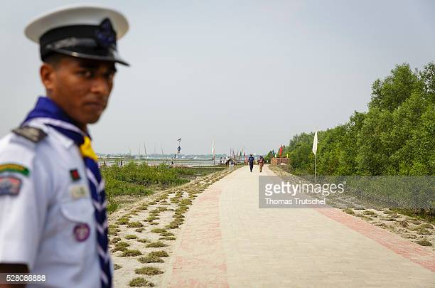 A police officer stands on a newly built street on a dam on April 12 2016 in Mongla Bangladesh