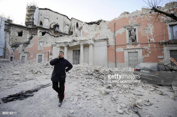 Police officer stands on April 6, 2009 in the center of the Abruzzo capital L'Aquila, the epicenter of an earthquake measuring 5.8-magnitude on the...