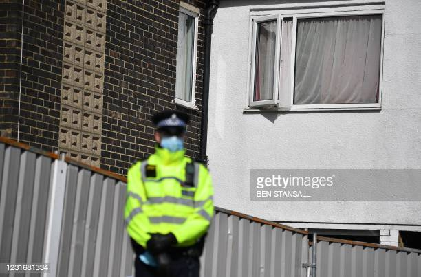 Police officer stands on duty outside a home in Deal, southeast England, on March 13, 2021 as officers continue the search for evidence in connection...