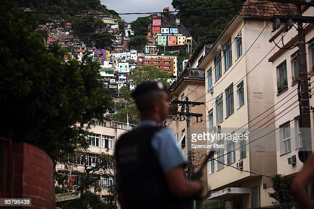 """Police officer stands on the edge of recently """"pacified"""" Santa Marta, one of Rio's oldest slums, or favela on December 3, 2009 in Rio de Janeiro,..."""
