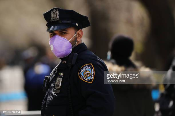 A police officer stands outside of Mount Sinai Hospital amid the coronavirus pandemic on April 01 2020 in New York City Hospitals in New York City...