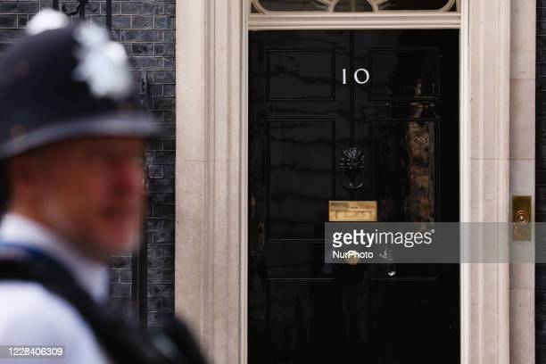 Police officer stands outside the door of No. 10 Downing Street in London, England, on September 8, 2020.