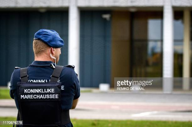 A police officer stands outside the extra secure court in Schiphol where the hearing in the Marengo criminal case takes place on September 24 2019...
