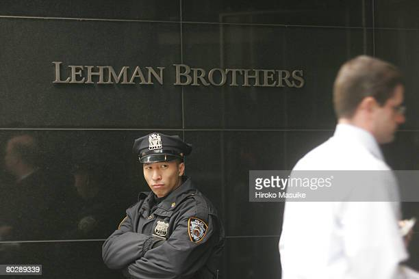Police officer stands outside the headquarters of Lehman Brothers in Times Square March 18, 2008 in New York City. Lehman posted a 57% decline in...