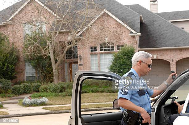 A police officer stands outside the Houston home of astronaut Lisa Marie Nowak Nowak a 43yearold Navy captain is charged with attempting to kidnap...