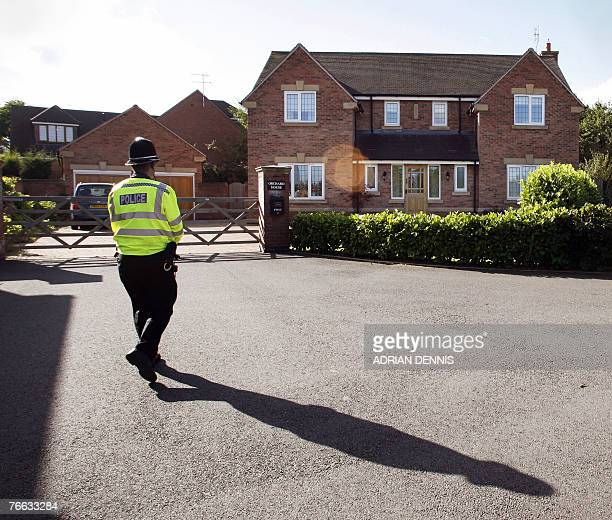 A police officer stands outside the McCann's house at the family home in Rothley Leicestershire in central England 10 September 2007 The parents of...