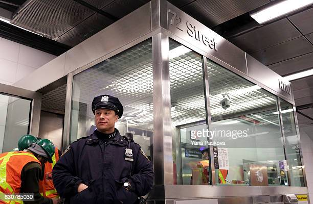 A police officer stands watch at the 72nd St Q train station on the newly opened Second Avenue subway line on January 01 2017 in New York City