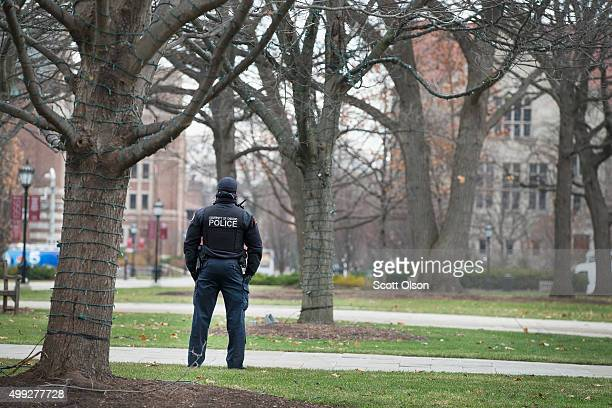 A police officer stands watch in the Main Quadrangles on the Hyde Park Campus of the University of Chicago on November 30 2015 in Chicago Illinois...