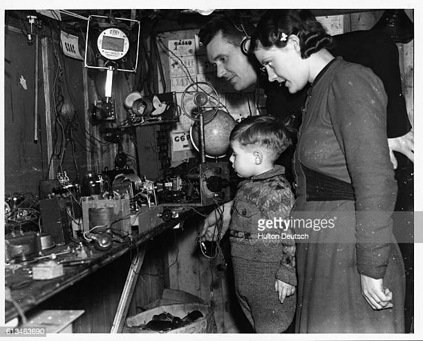 Police officer Stanley Hardman is a radio enthusiast in his spare time and is seen here at home with his wife and son using his own transmitting and...