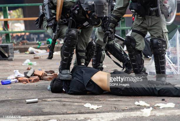 A police officer steps on the head of a protester during the demonstration Police surround the Polytechnic University after prodemocratic protesters...