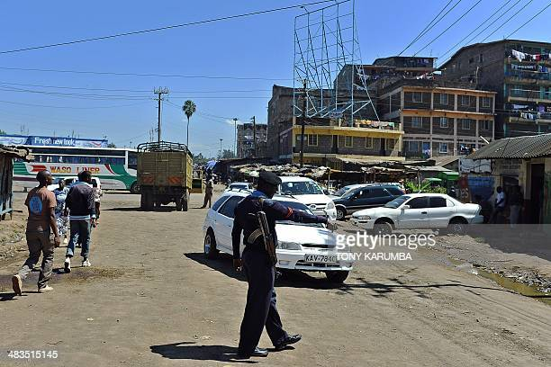 A police officer stops a vehicle at a road block set up in the Somali district of Eastleigh in Nairobi on April 9 2014 Dozens of Somalis have been...