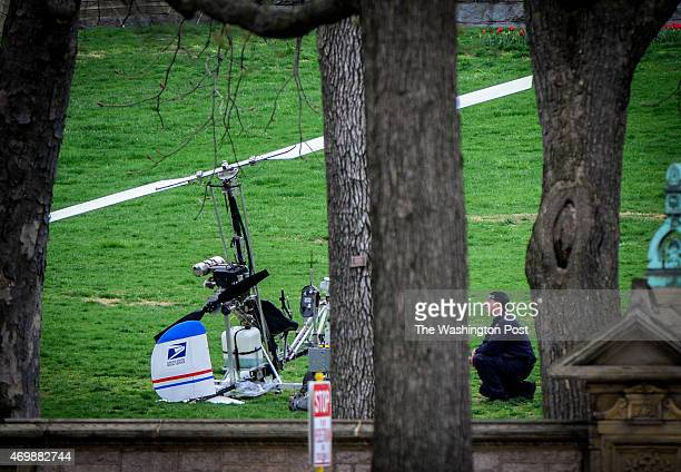 A police officer studies a gyrocopter that has landed on the west front lawn of the Capitol on April 2015 in Washington DC
