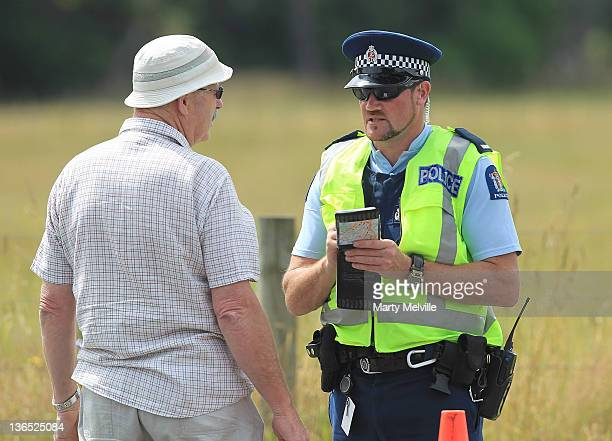 Police officer takes details from a resident at the cordon on January 7 2012 in Carterton New Zealand Emergency services attended a hot air balloon...