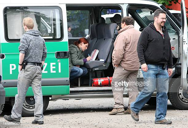 A police officer takes notes in a van outside of the clubhouse of the motorcycle gang Bandidos Del Este on June 7 2012 in Hennigsdorf just outside of...