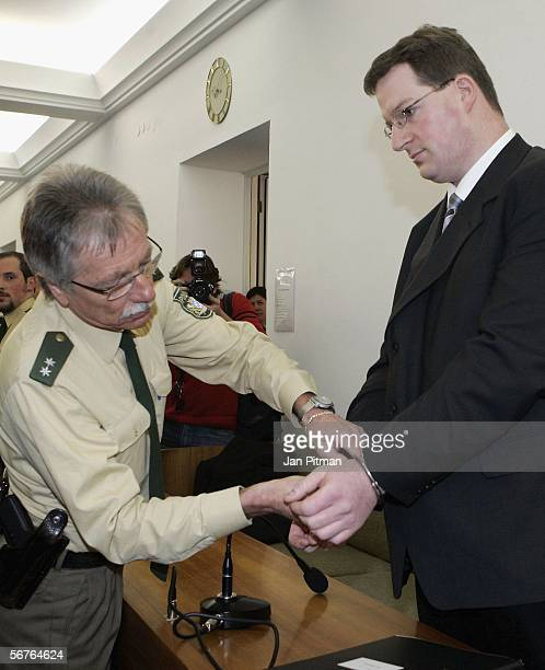 A police officer takes off the handcuffs of Stephan L in a court room at the beginning of his trial on February 7 2006 in Kempten Germany 27 years...