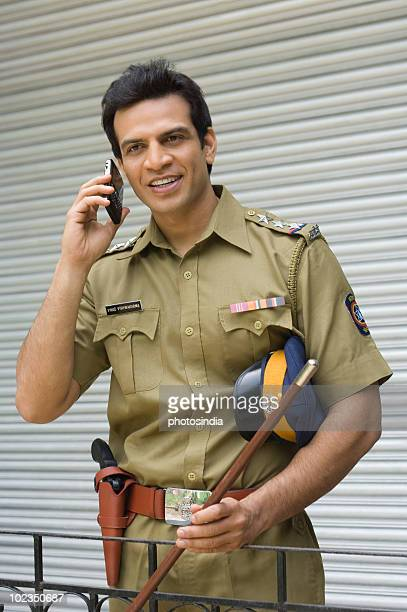 Police officer talking on a mobile phone