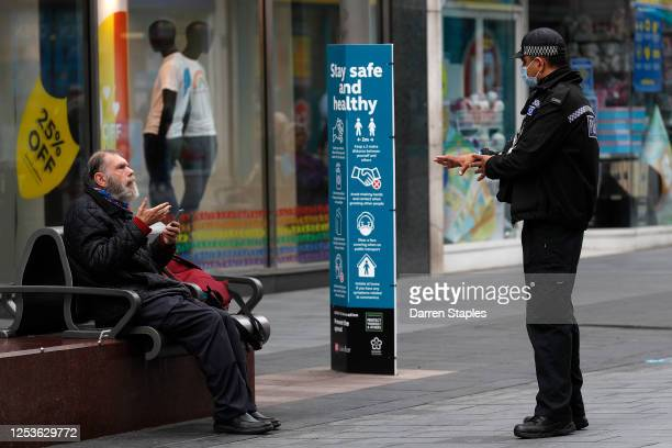 Police officer talks to a man sitting on a bench during lockdown on July 01, 2020 in Leicester, England. Ten per cent of all the recent UKs Covid-19...