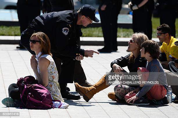 A police officer talks to protesters during a Democracy Spring demonstration on Capitol Hill in Washington DC on April 13 calling to change voting...