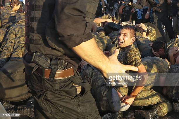 A police officer talks with the soldiers involved in the coup attempt after they surrendered on Bosphorus bridge on July 16 2016 in Istanbul Turkey...