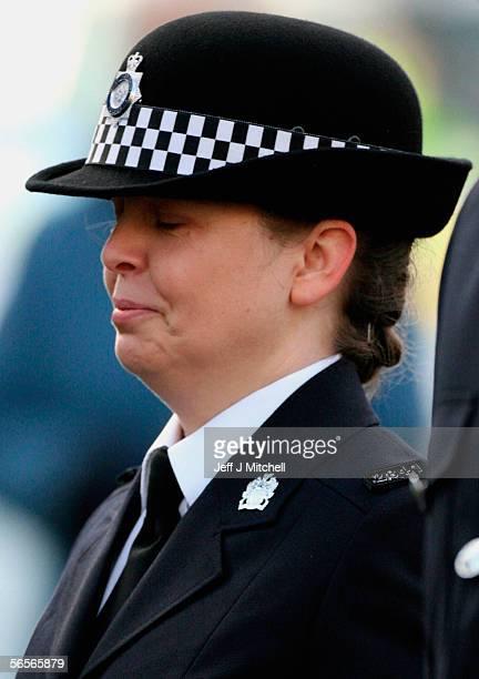 Police officer Teresa Milburn walks behind the funeral cortege of Police Constable Sharon Beshenivsky at Bradford South Police Headquarters on...