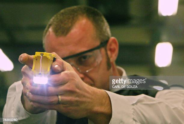 A police officer trains using a taser gun at the Metropolitan Police Specialist Training Centre in Gravesend Kent in southeast England 05 December...