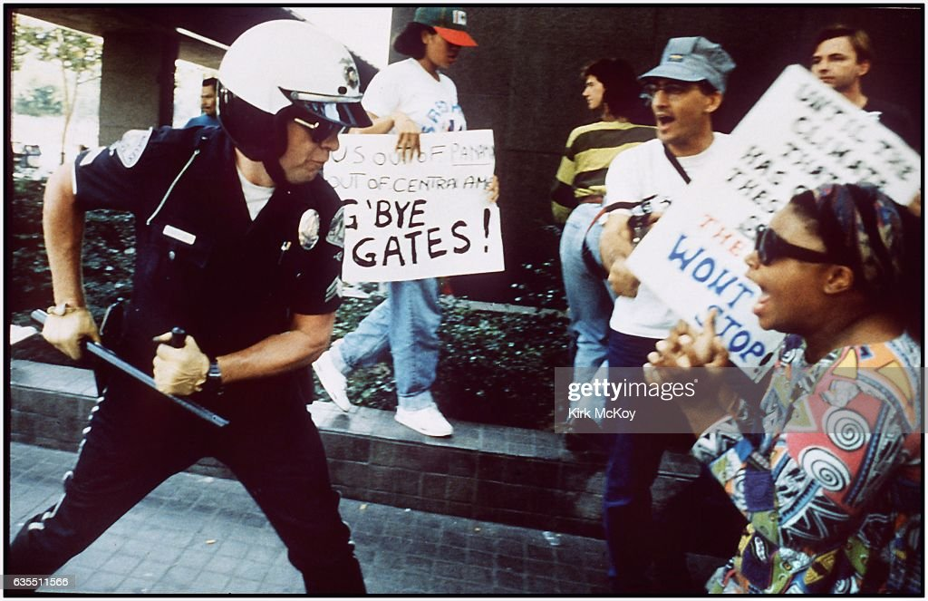 Police officer uses his baton on a protester at the corner of First St. and Broadway (downtown) on April 29, 1992 in Los Angeles, California.