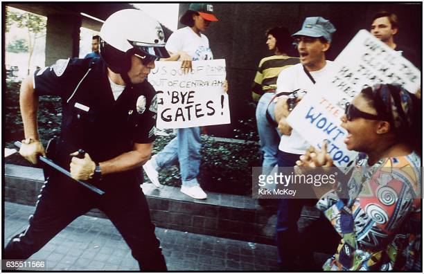 Police officer uses his baton on a protester at the corner of First St and Broadway on April 29 1992 in Los Angeles California