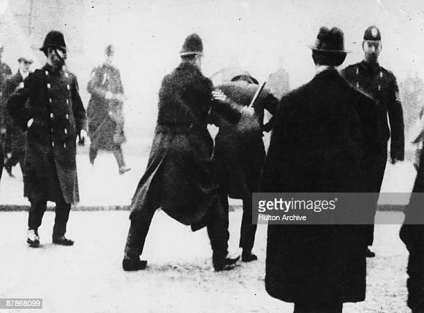 A police officer uses his baton on a striker during a general strike in Glasgow January 1919 Tensions mounted culminating in the Battle of George...