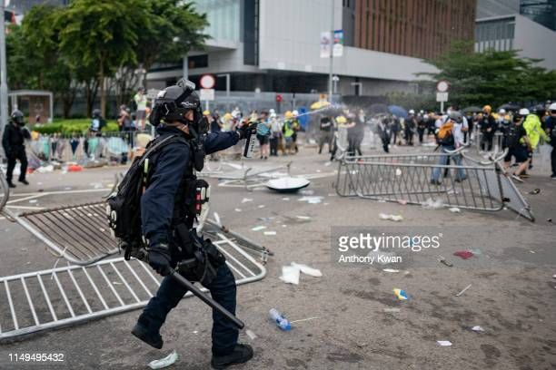 A police officer uses pepper spray during a protest on June 12 2019 in Hong Kong China Large crowds of protesters gathered in central Hong Kong as...