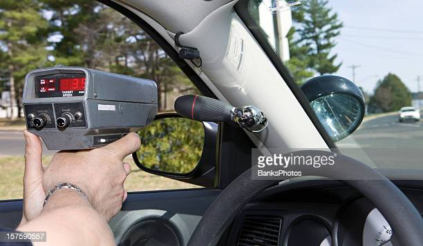 Police Officer Using a Handheld RADAR gun