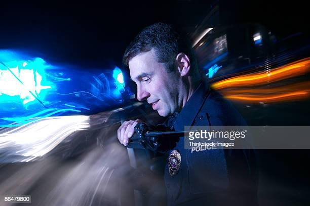 Police officer using radio
