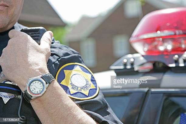 police officer using radio to call for backup - law enforcement stock photos and pictures