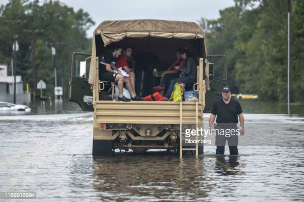 A police officer waits for help on a flooded highway following Tropical Storm Imelda in Fannett Texas US on Friday Sept 20 2019 The remnants of...