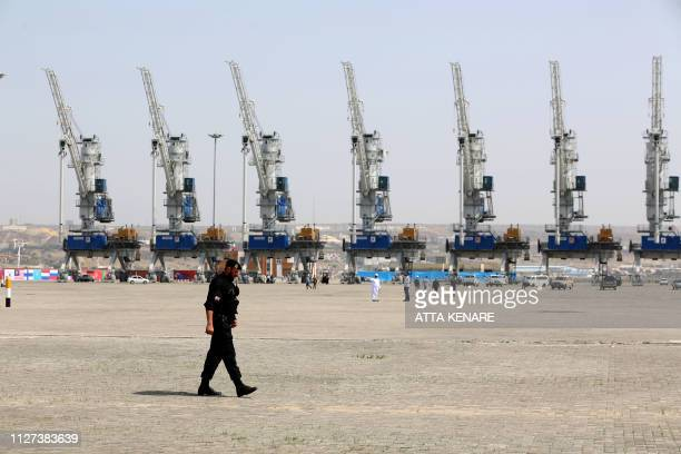 A police officer walks around during an inauguration ceremony of new equipment and infrastructure at Shahid Beheshti Port in the southeastern Iranian...