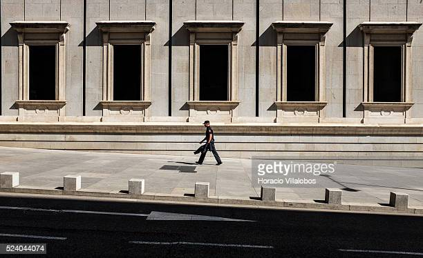 A Police officer walks by the Congress of Deputies building in Madrid Spain 13 September 2013 The Spanish Congress of Deputies is the lower house of...