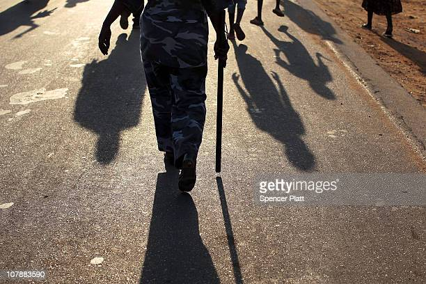 A police officer walks in a pro independence march January 5 2011 in Juba Sudan Southern Sudan is preparing for an independence referendum to take...