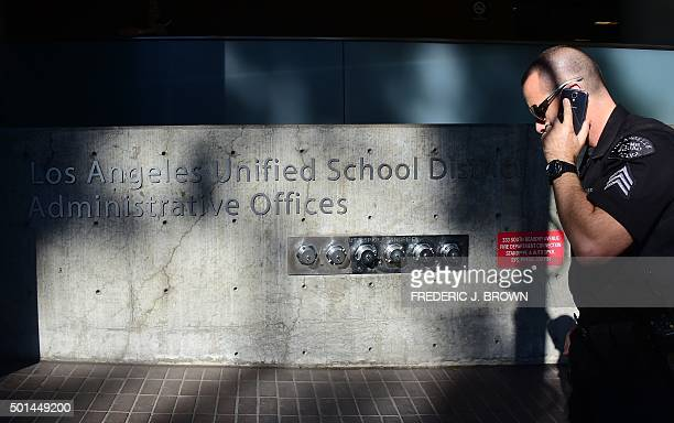 A police officer walks past the administrative offices of the Los Angeles Unified School District where schools superintendant Ramon CortinesMayor...