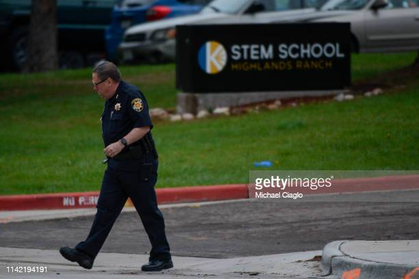 A police officer walks past the STEM School Highlands Ranch entrance on May 8 2019 in Highlands Ranch Colorado one day after a shooting there killed...