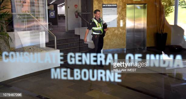 A police officer walks through the foyer of the Consulate General of India in Melbourne on January 9 2019 Australian police are investigating the...
