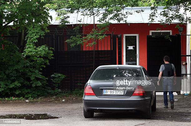 A police officer walks towards the gate of the clubhouse of the motorcycle gang Bandidos Del Este on June 7 2012 in Hennigsdorf just outside of...