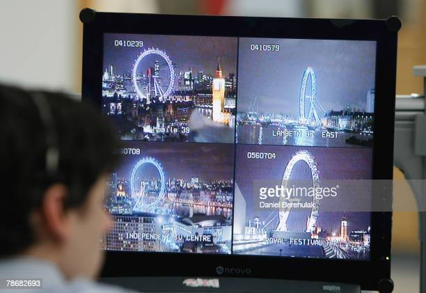A police officer watches a television monitor displaying a fraction of London's CCTV camera network in the Metropolitan Police's Special Operations...