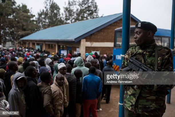 A police officer watches over a polling station at Olympic Primary School in Kibera one of the largest slums in Africa on August 8 2017 in Nairobi...