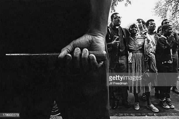 A police officer watches the residents of Resurrection City a three thousand person tent city on the Washington Mall set up as part of the Poor...