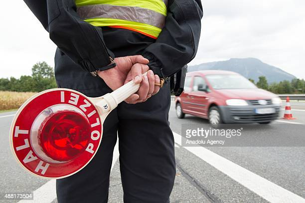 A police officer watches traffic at the German Austrian border on September 14 2015 near Bad Reichenhall Germany Germany has temporarily introduced...