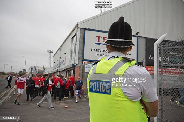 A police officer watching on as supporters of Hartlepool United and Middlesbrough make their way to the Victoria Ground Hartlepool before the...