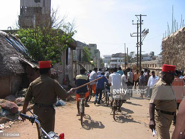 PONDICHERRY INDIA A police officer waves his baton to clear a coastal area in Pondicherry India after a warning Thursday December 30 about the...