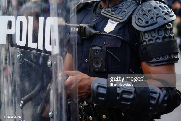 A police officer wearing a body cam is seen during a demonstration on May 31 2020 in Atlanta Georgia Across the country protests have erupted...